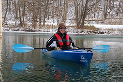 Ginger kayaking among the ice on Lake Springfield