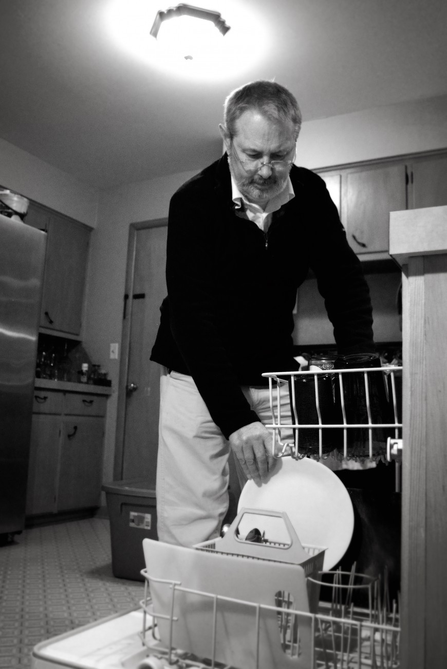 Stacking the dishwasher by Gary Allman
