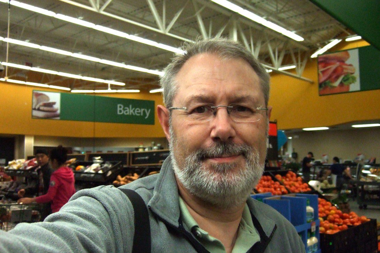 Photograph of Gary Allman in the Walmart veggies section