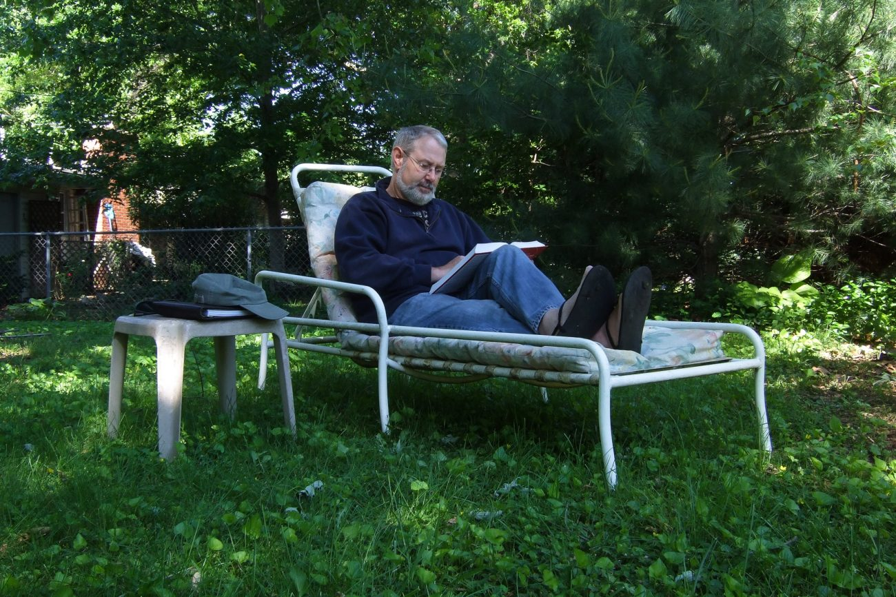 photograph of Gary Allman studying for EFM in the backyard
