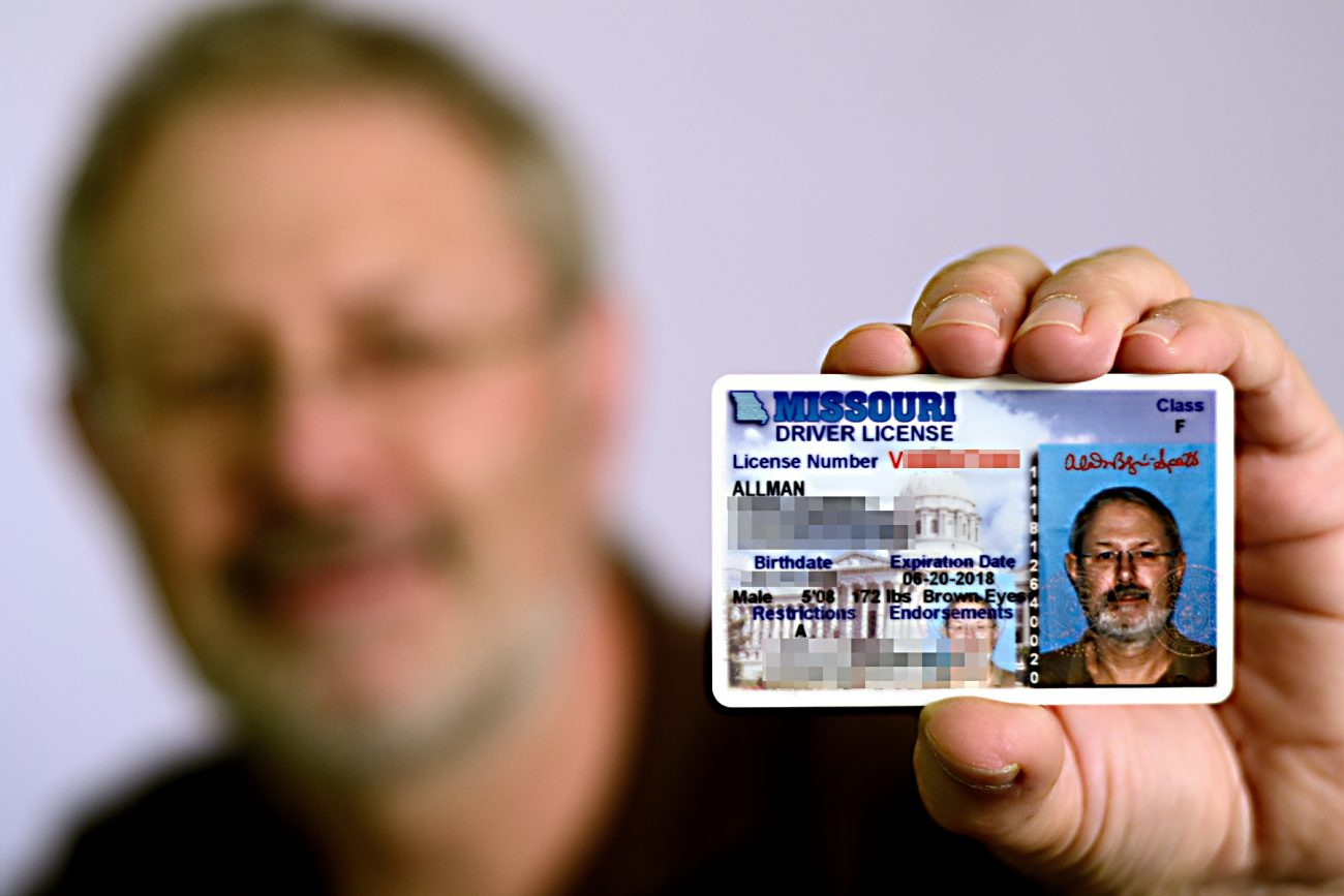 Picture of Gary Allman showing his Missouri Driving License (details obscured).
