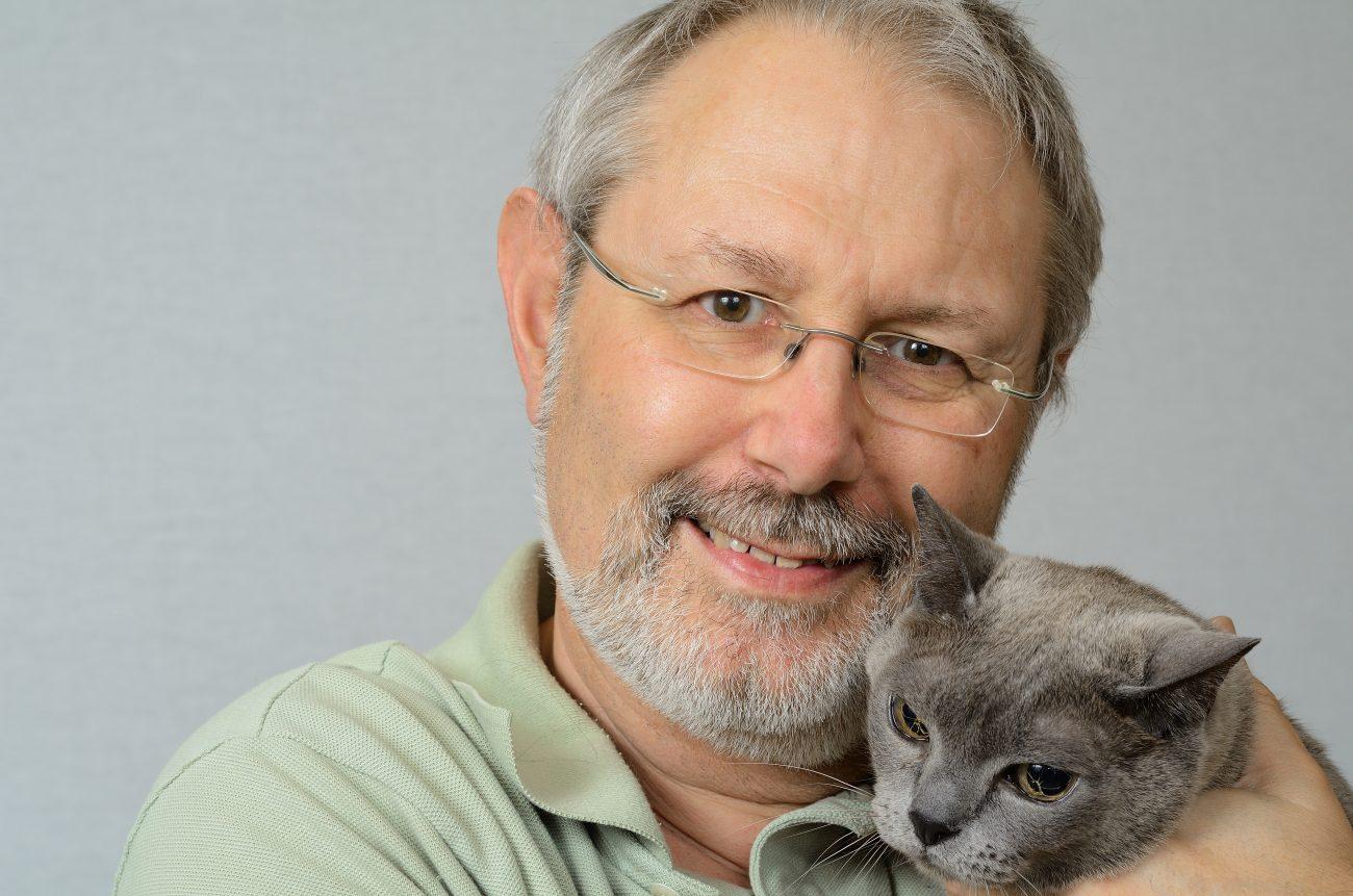 Photograph of Gary Allman and Tubby - a Burmese cat.