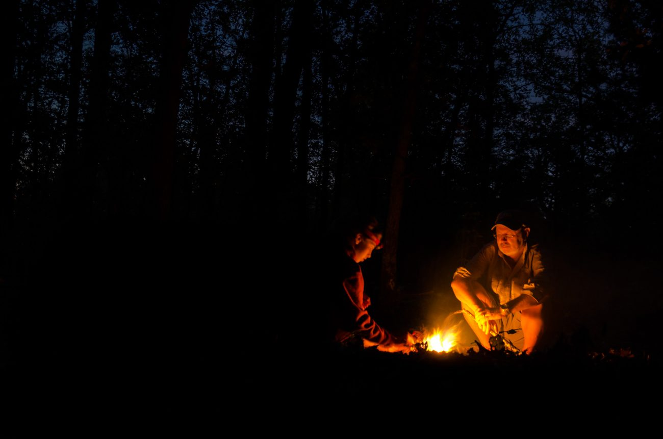 Gary and Lanie tending the campfire - Photo by Ginger