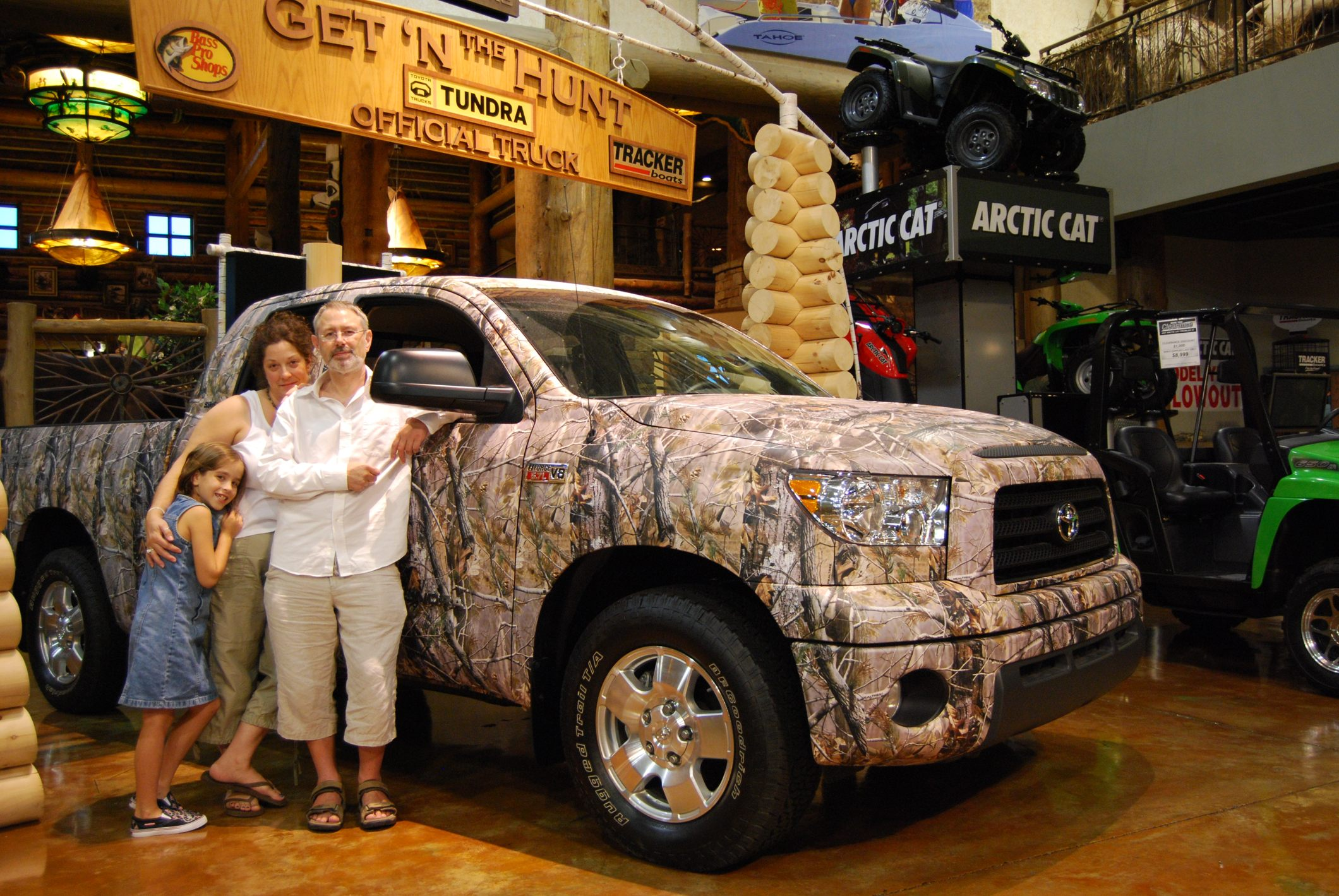 Gary Allman, Ginger Davis Allman and Lanie alongside a Camo decorated Toyota Tundra Pick-up