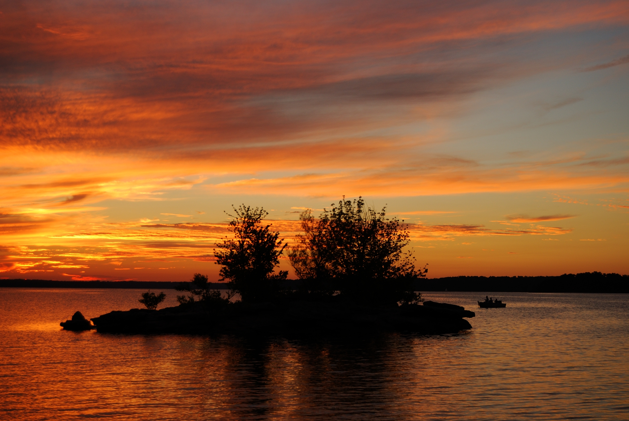 Sunset at Stockton Lake, Missouri. Photograph showing the sunset, and a small island.