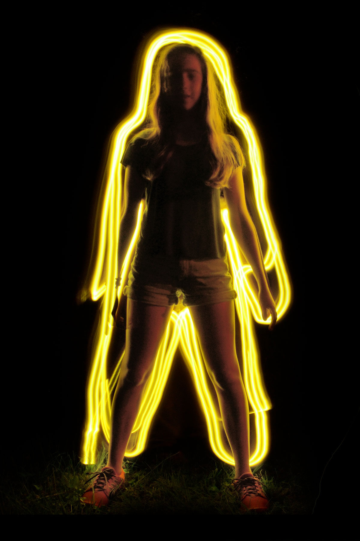 Photograph of Lanie surrounded by a yellow glow