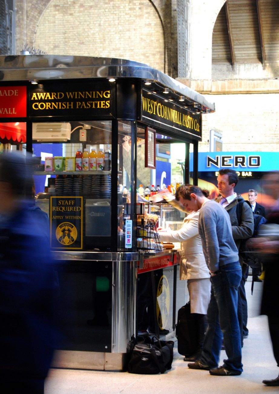 People lining up at a retail kiosk in Kings Cross Station