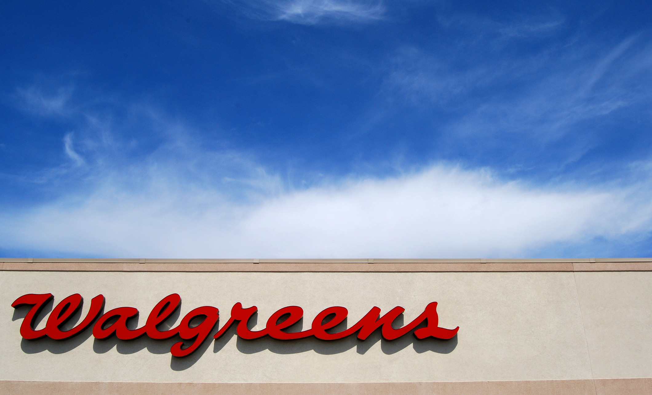 Walgreens sign topped by ablue sky with wispy clouds