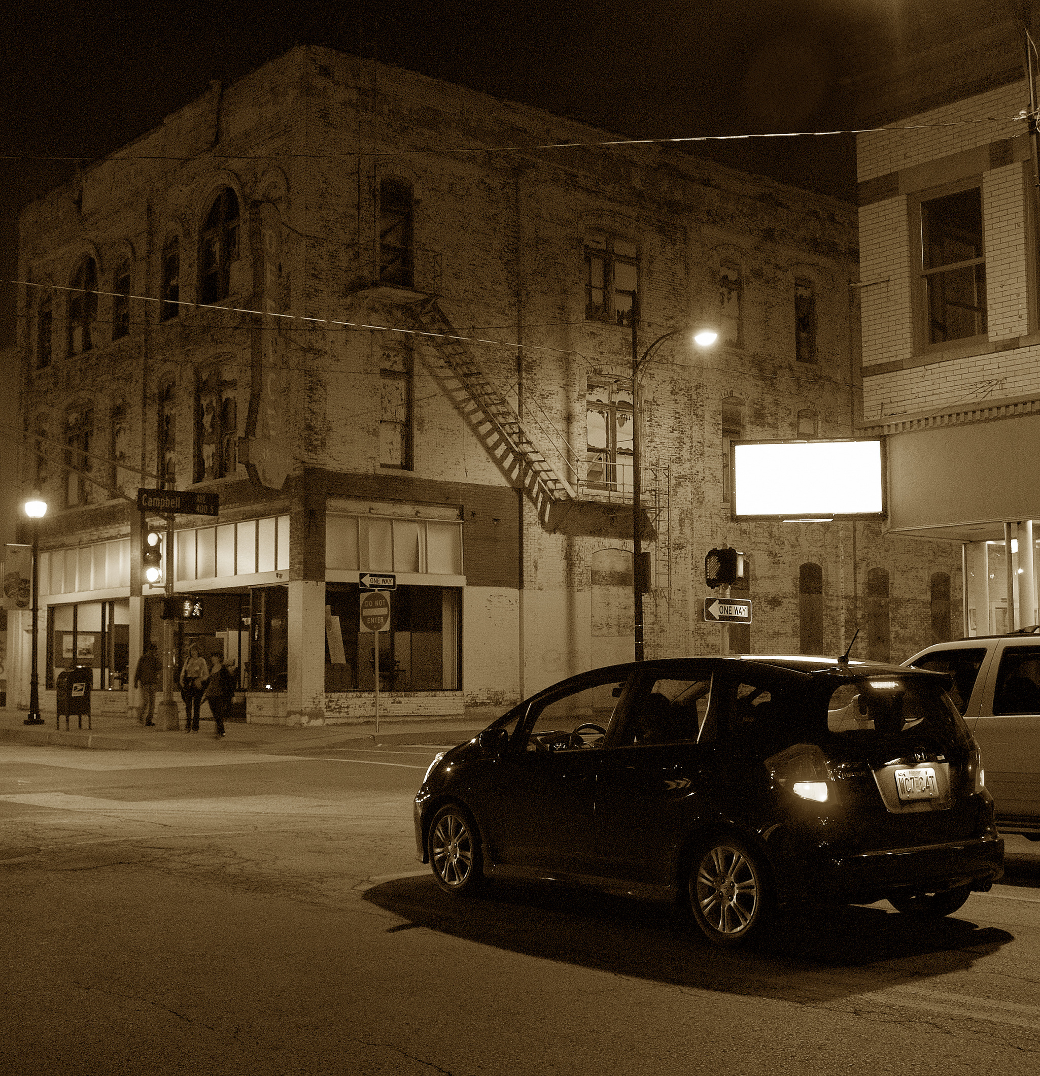 The junction of South Campbell Avenue and West Walnut Street, Springfield Missouri at night