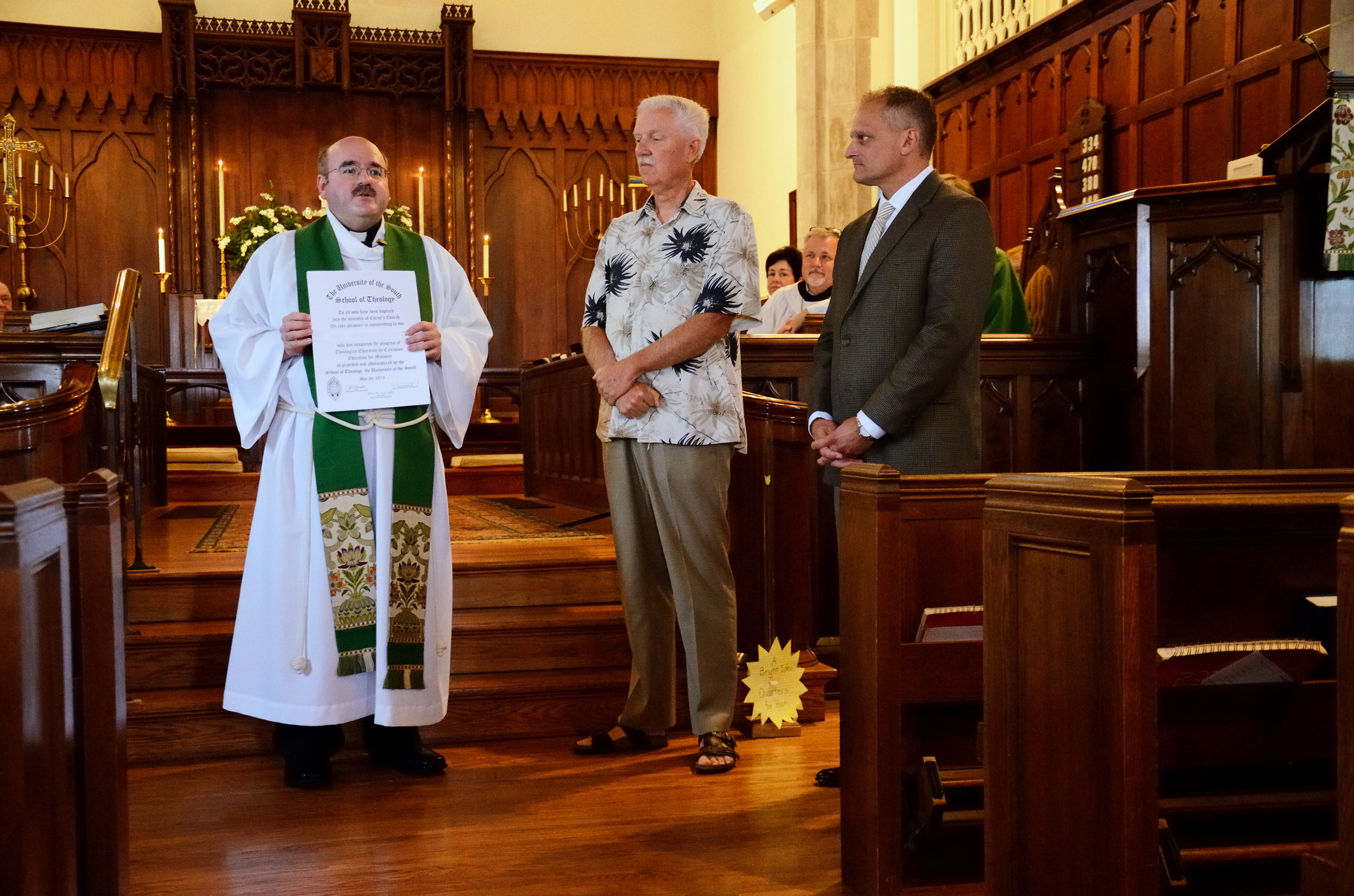 Fr. Jonathan shows off the EfM certificates