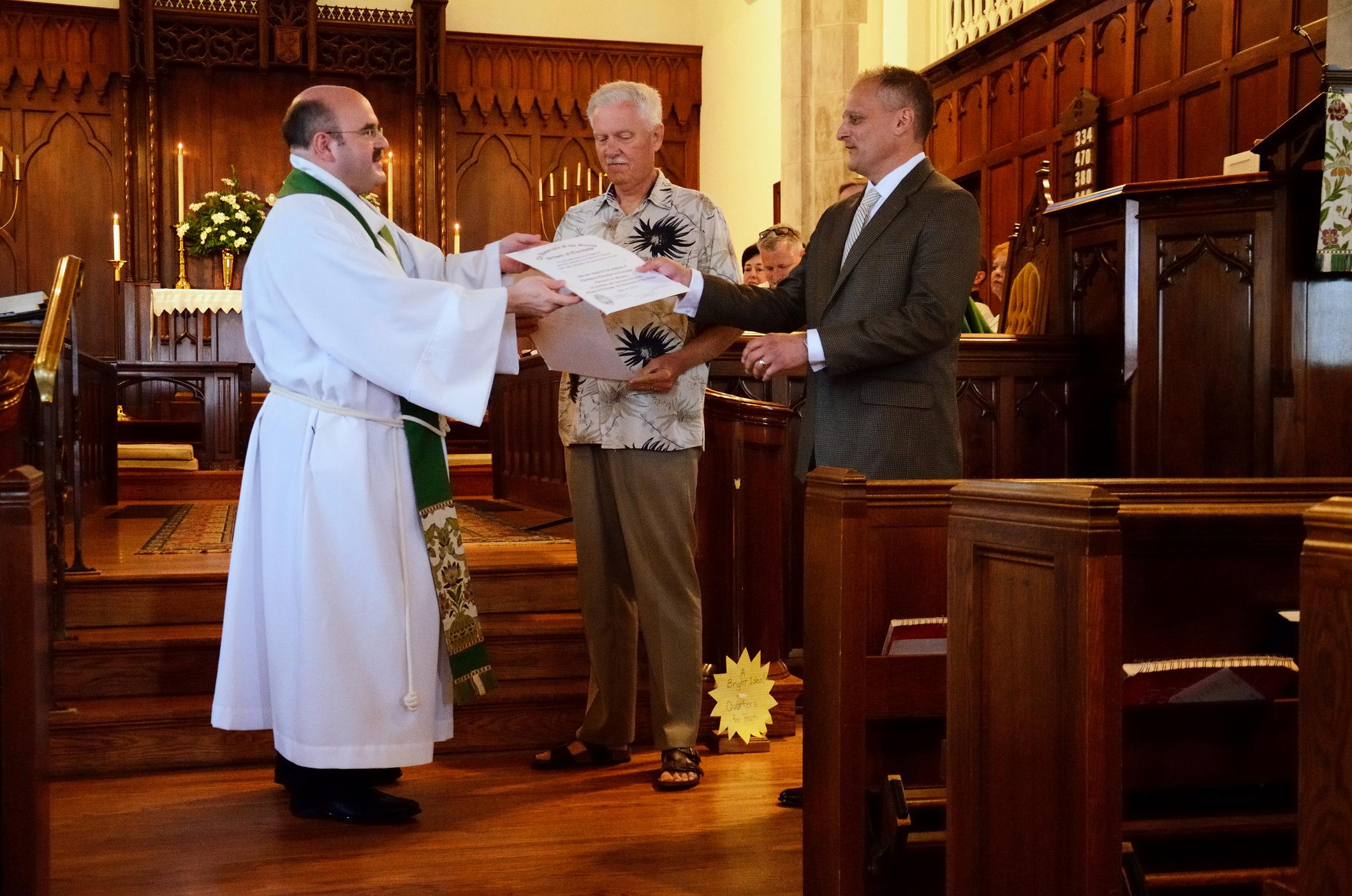 Kris receives his EfM certificate