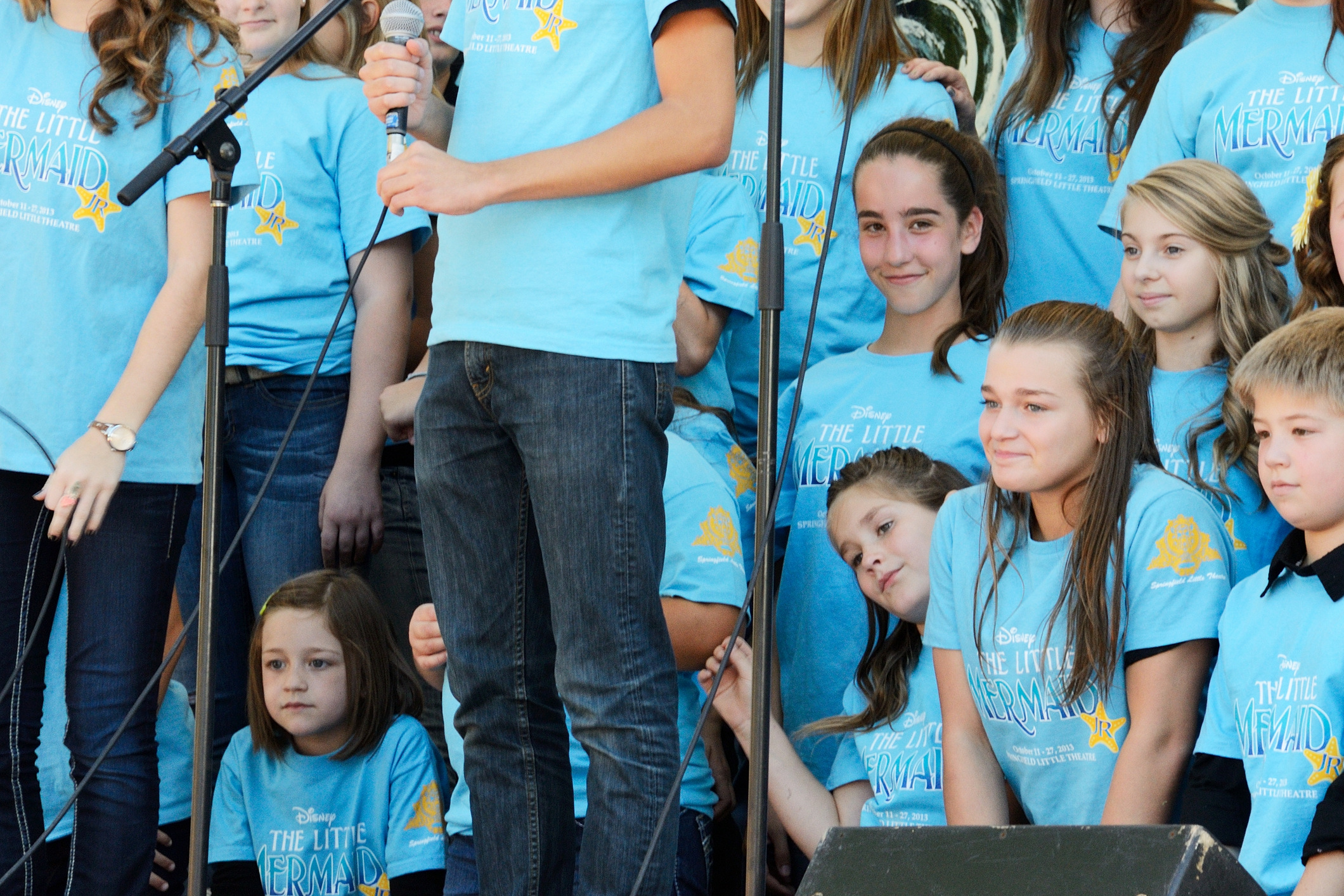 Lanie on stage with The Little Mermaid cast at Cider Days