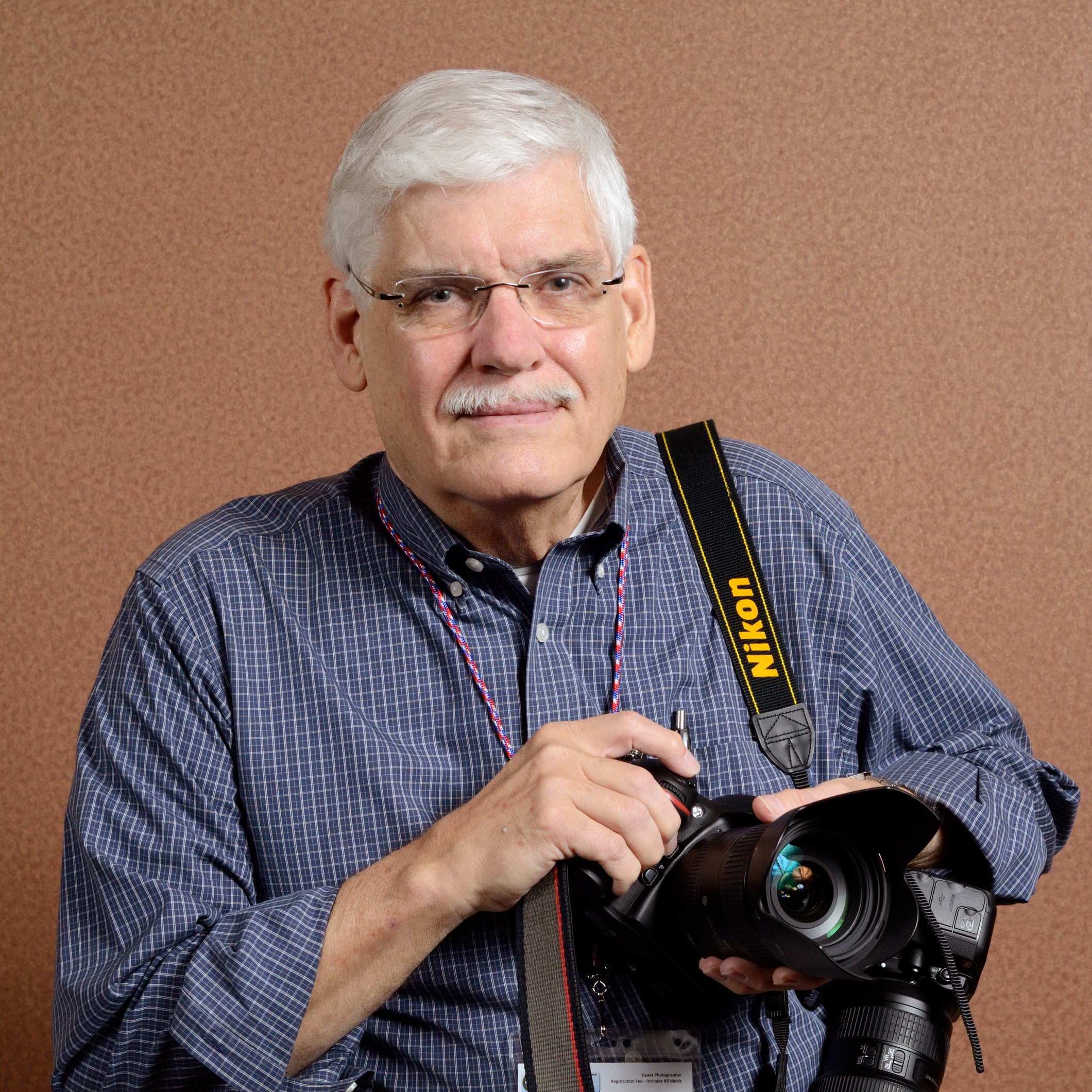 Fellow Photog. at the Diocese Convention Gary Zumwalt. I wanted to get a picture of Gary with his cameras.