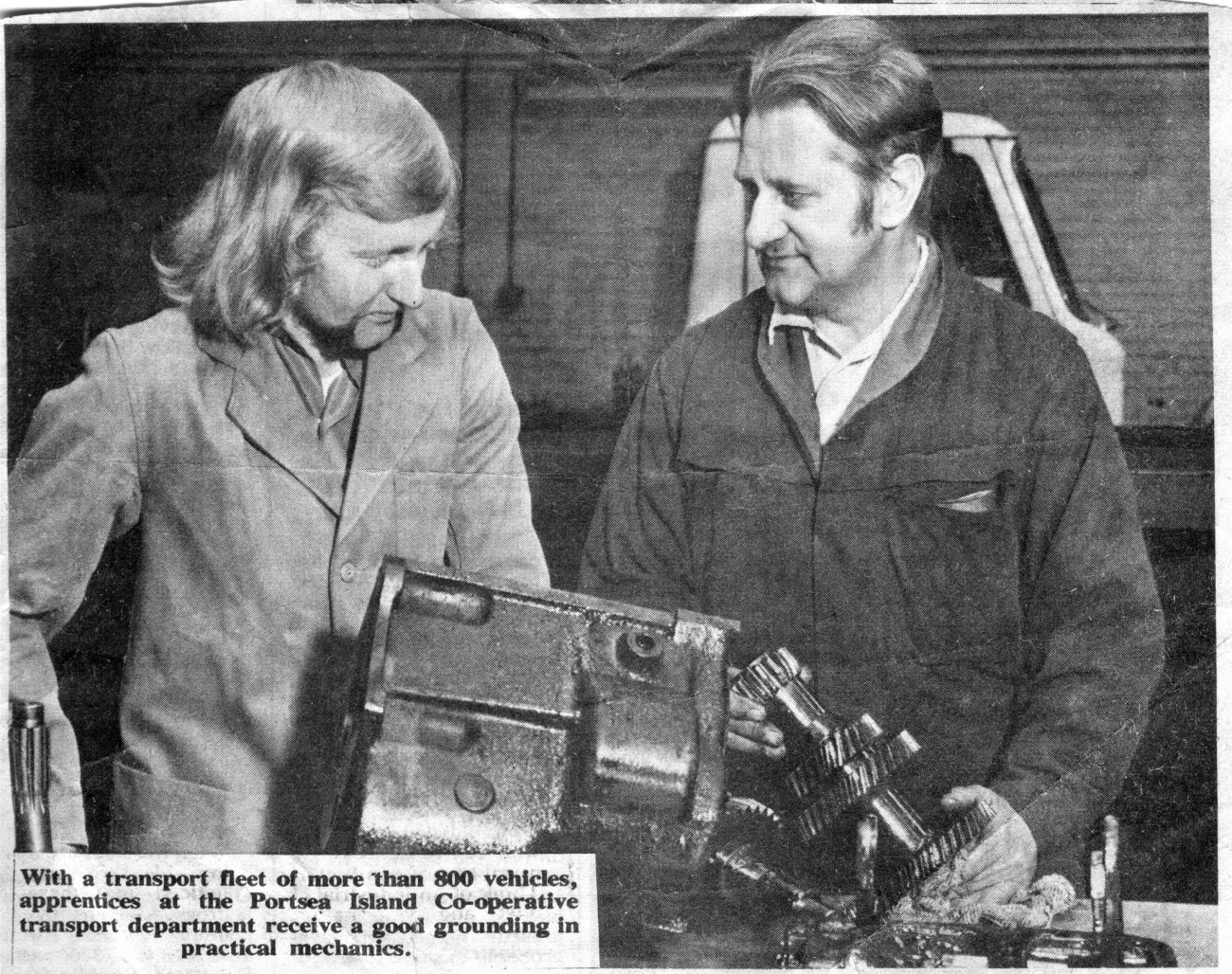 C1973 Father giving some gearbox maintenance training for the benefit of the local paper.