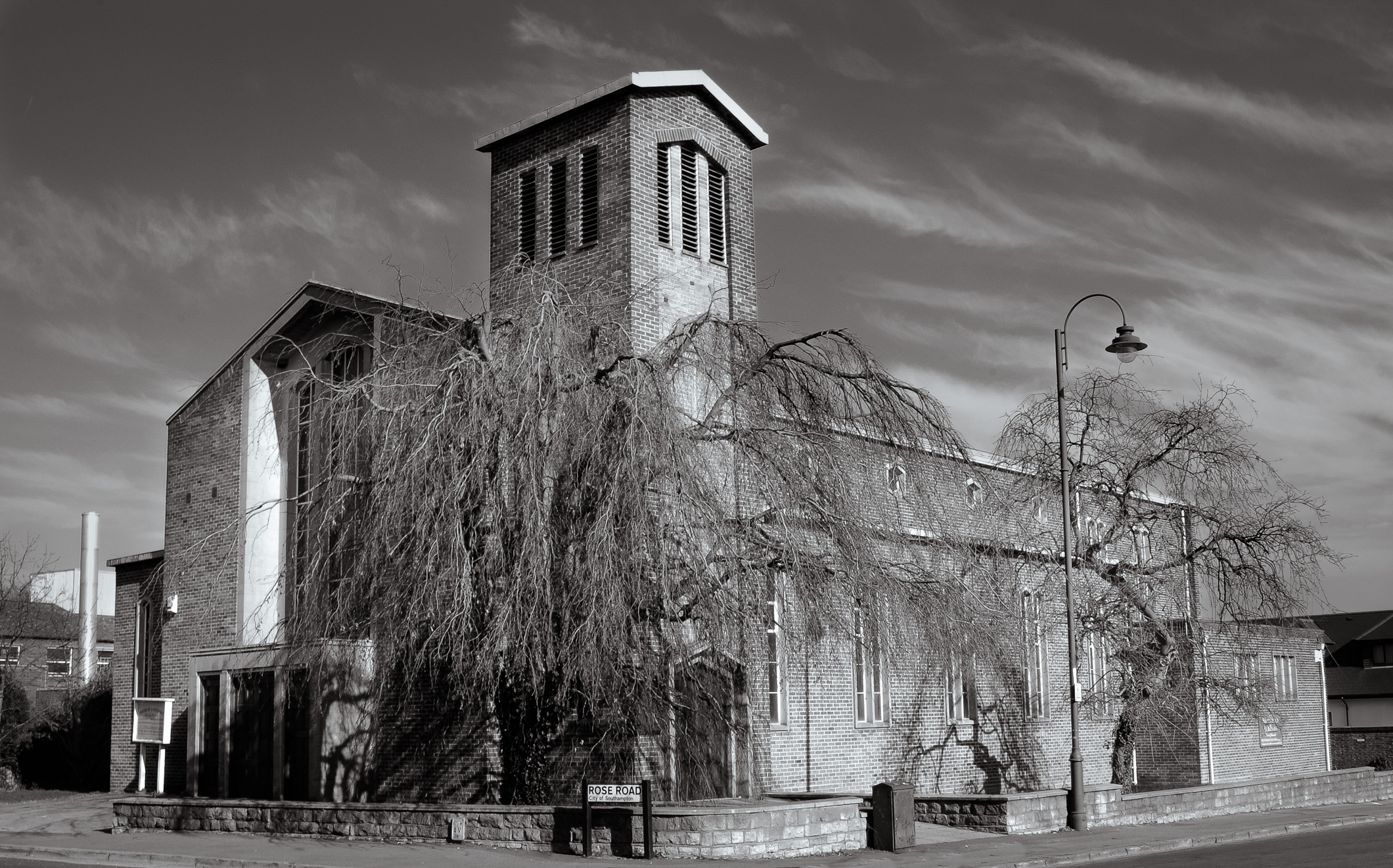 Black and white picture of the exterior of the brick built St. Barnabas Church, Rose Road, Southampton, England.