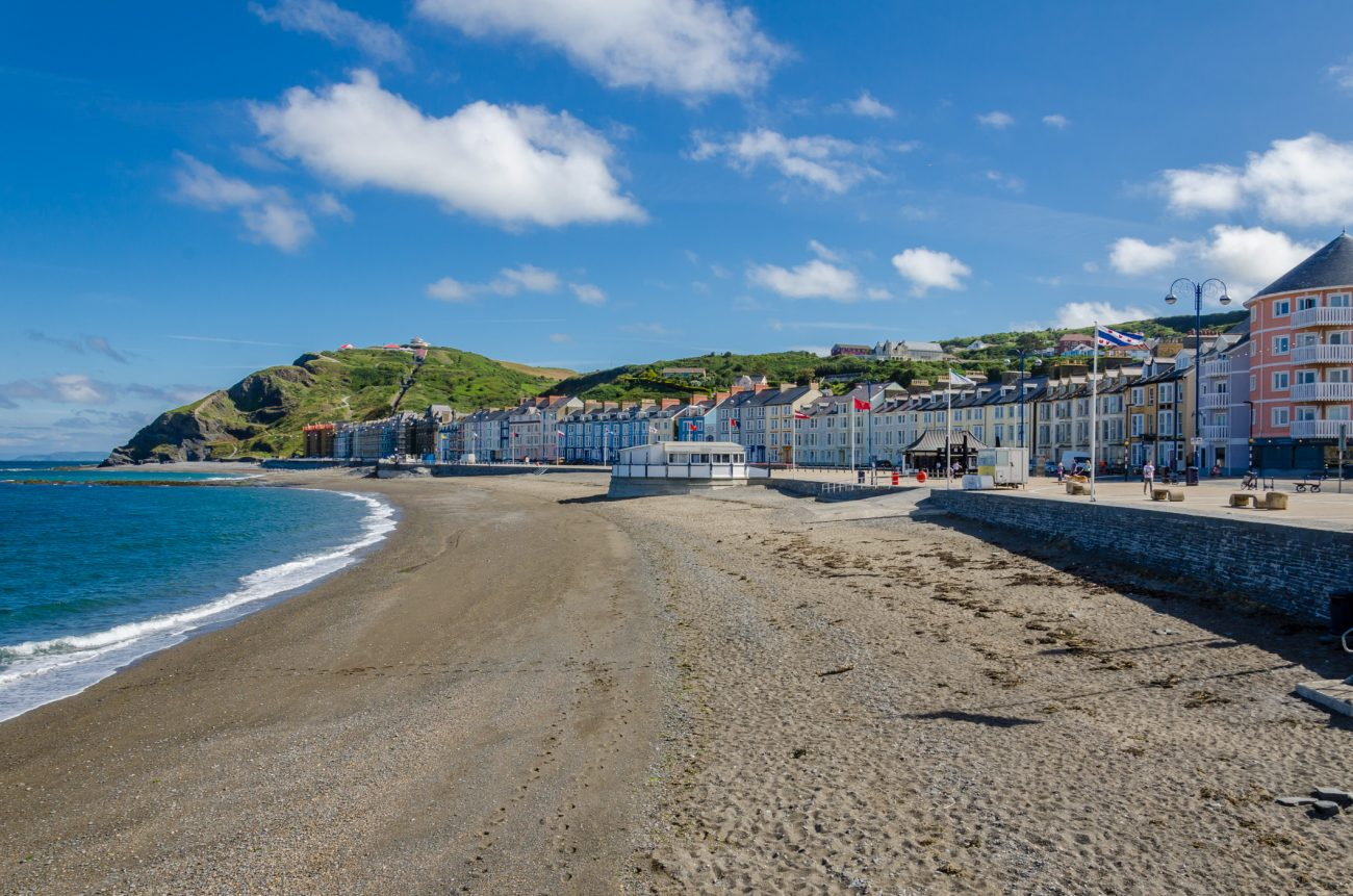 Color photograph showing the view along the seafront at Aberystwyth, Wales. June 24, 2014.