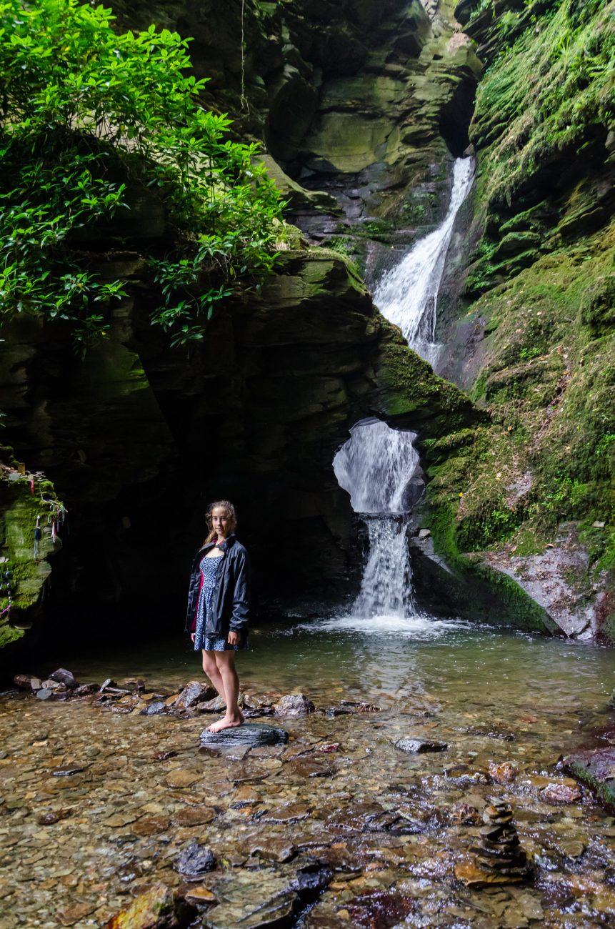 Lanie in front of the 60ft waterfall at St. Nectan's Klieve - St. Necan's Glen, Cornwall UK