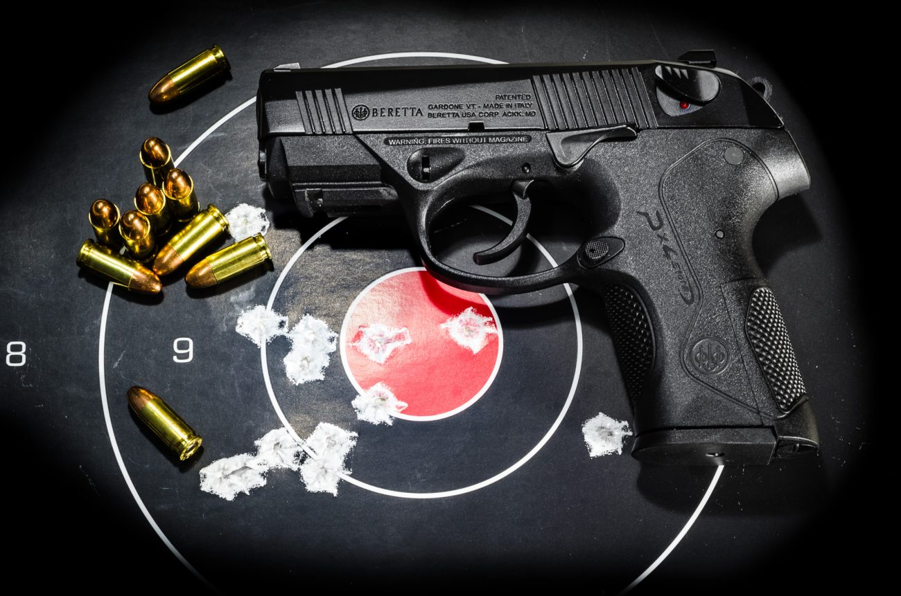 Color Photograph of a Beretta 9mm PX4 Storm Compact handgun with target