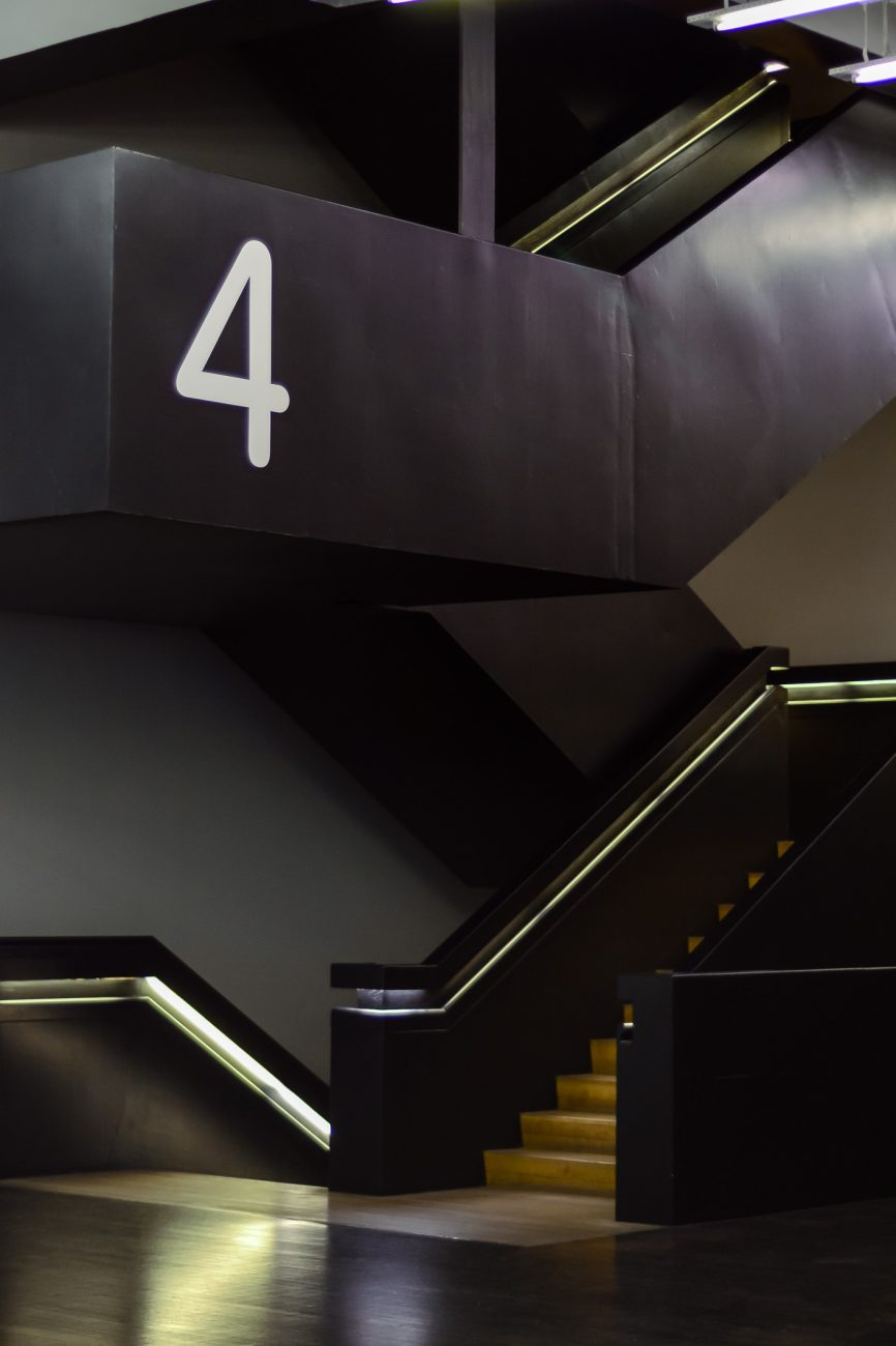 Staircase with Floor 4 marking at the Tate Modern, London UK