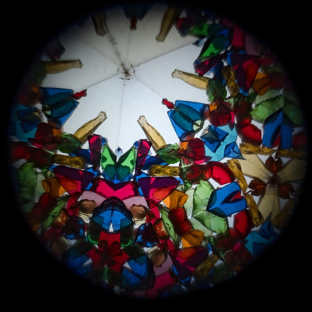 View through a Kaleidoscope eyepiece showing colored glass shards
