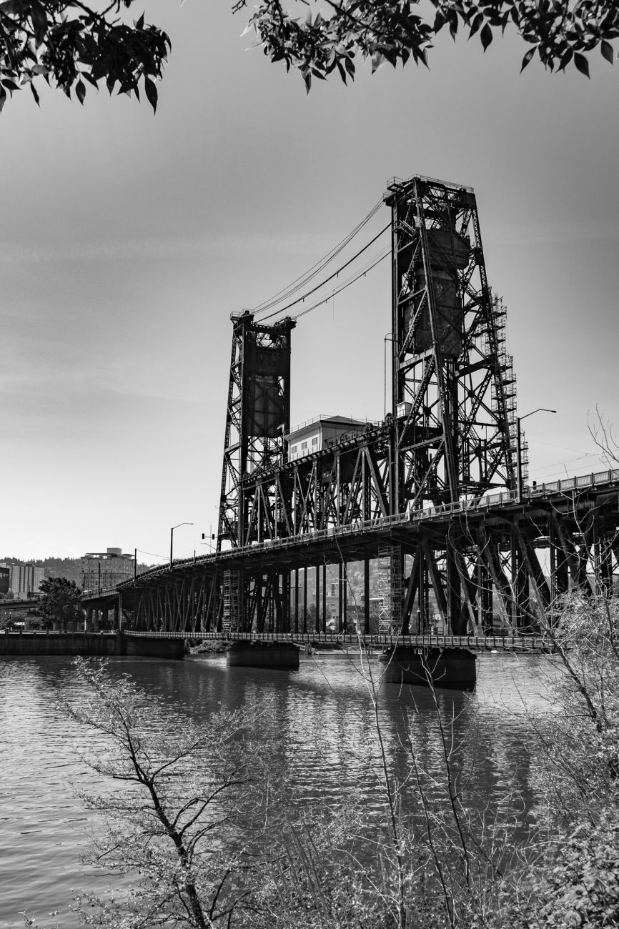 Black and white image of Steel Bridge, Willamette River, Portland, Oregon.