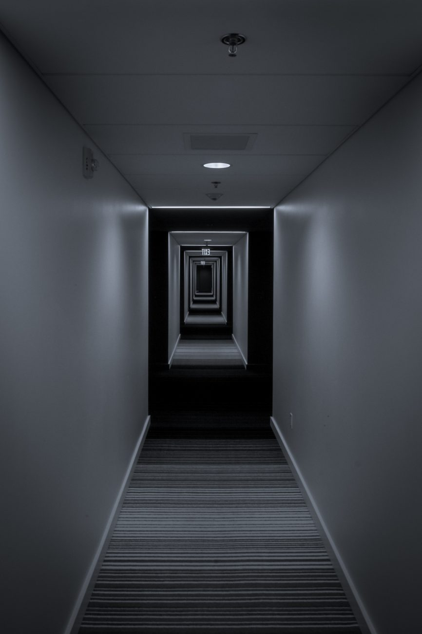 Hotel Eastlund, Portland Oregon. Corridor seemingly stretching to infinity. Black and White Photograph.