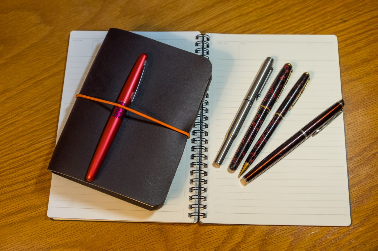 Journaling reboot: Photograph of a home-made leather journal and fountain pens