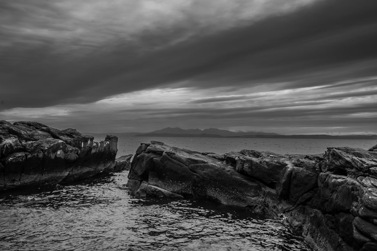 View from the near the road near Largs Scotland across the Firth of Clyde towards Great Cumrae and Bute. Black and White Photograph