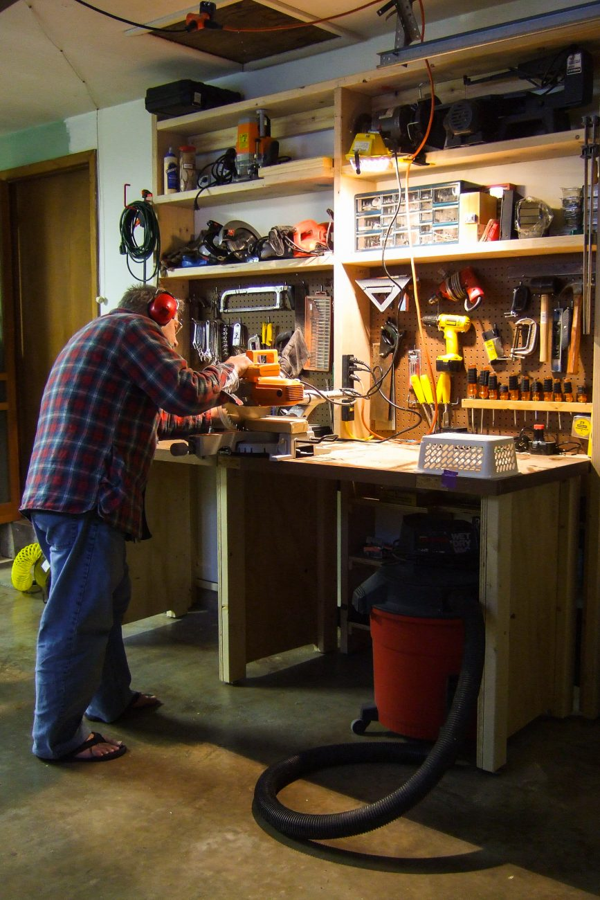 Photograph of Gary Allman working on a DYI project at his workbench in Springfield Missouri