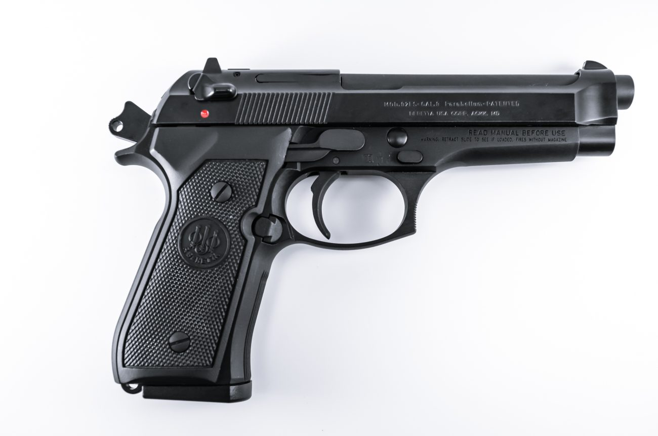 Photograph of a Beretta 92FS, Hammer cocked, safety off.