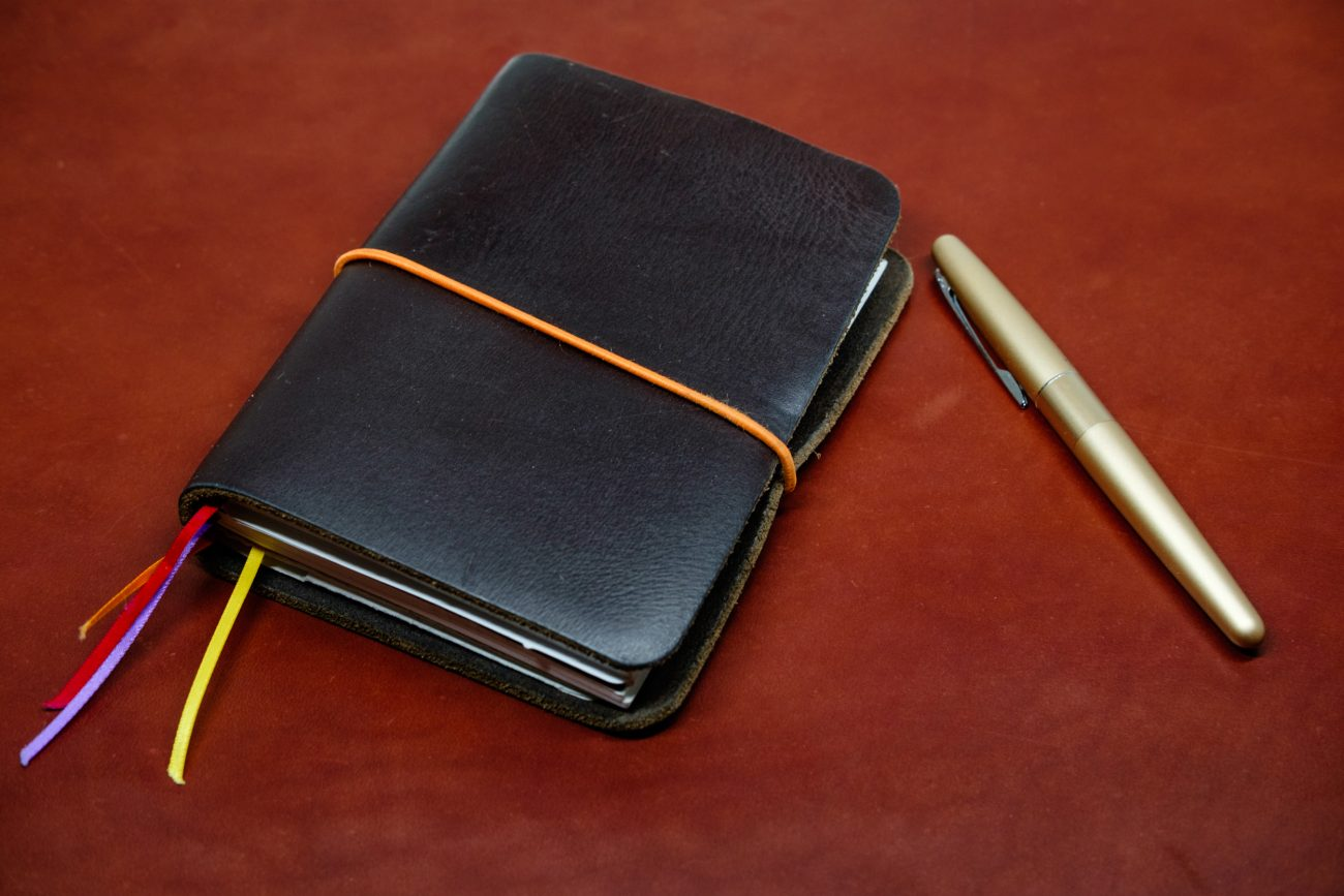Photograph of a leather bound journal and Pilot metropolitan fountain pen