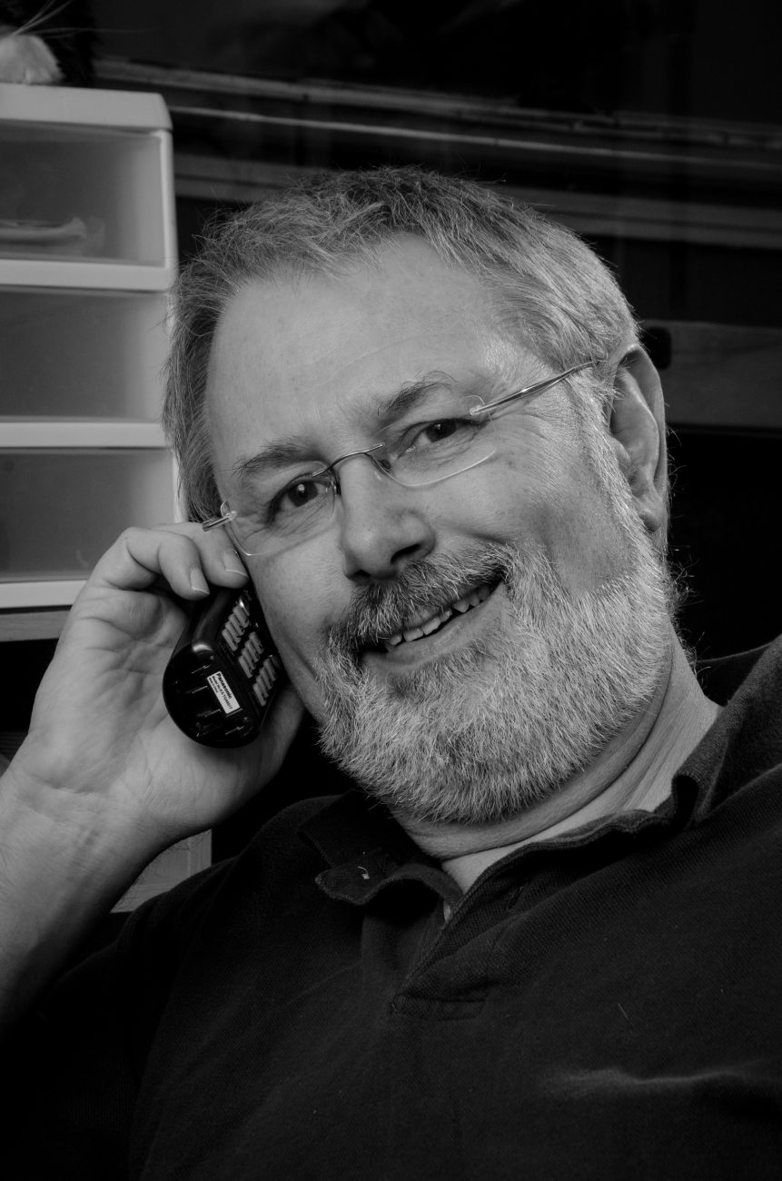 Black and white photograph of gary Allman (Springfield Missouri) talking on the telephone.