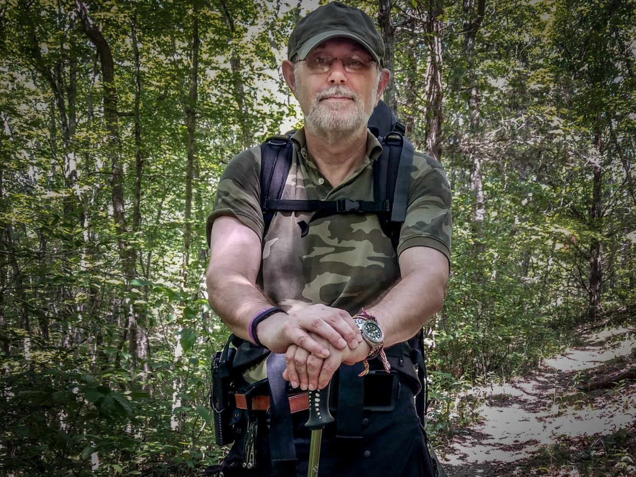 Color photograph of Gary Allman backpacking on the Ozark / Berryman Trail.