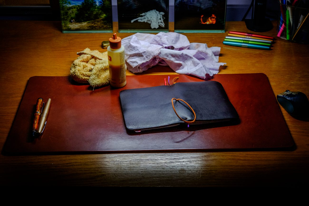 Photograph of a leather Journal and Desk pad during cleaning with leather oil