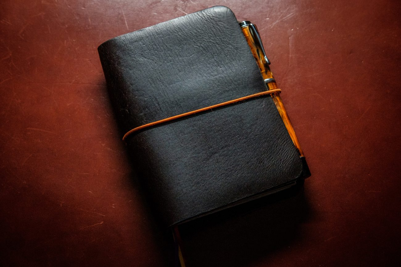 Photograph of a leather Journal and Desk pad after cleaning with leather oil