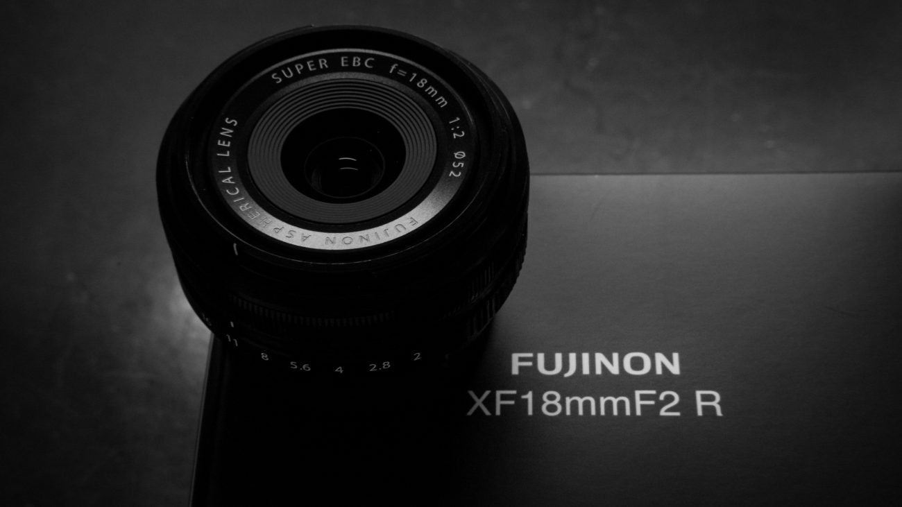 Black and white photograph of a Fujinon XF18mmF2 R lens