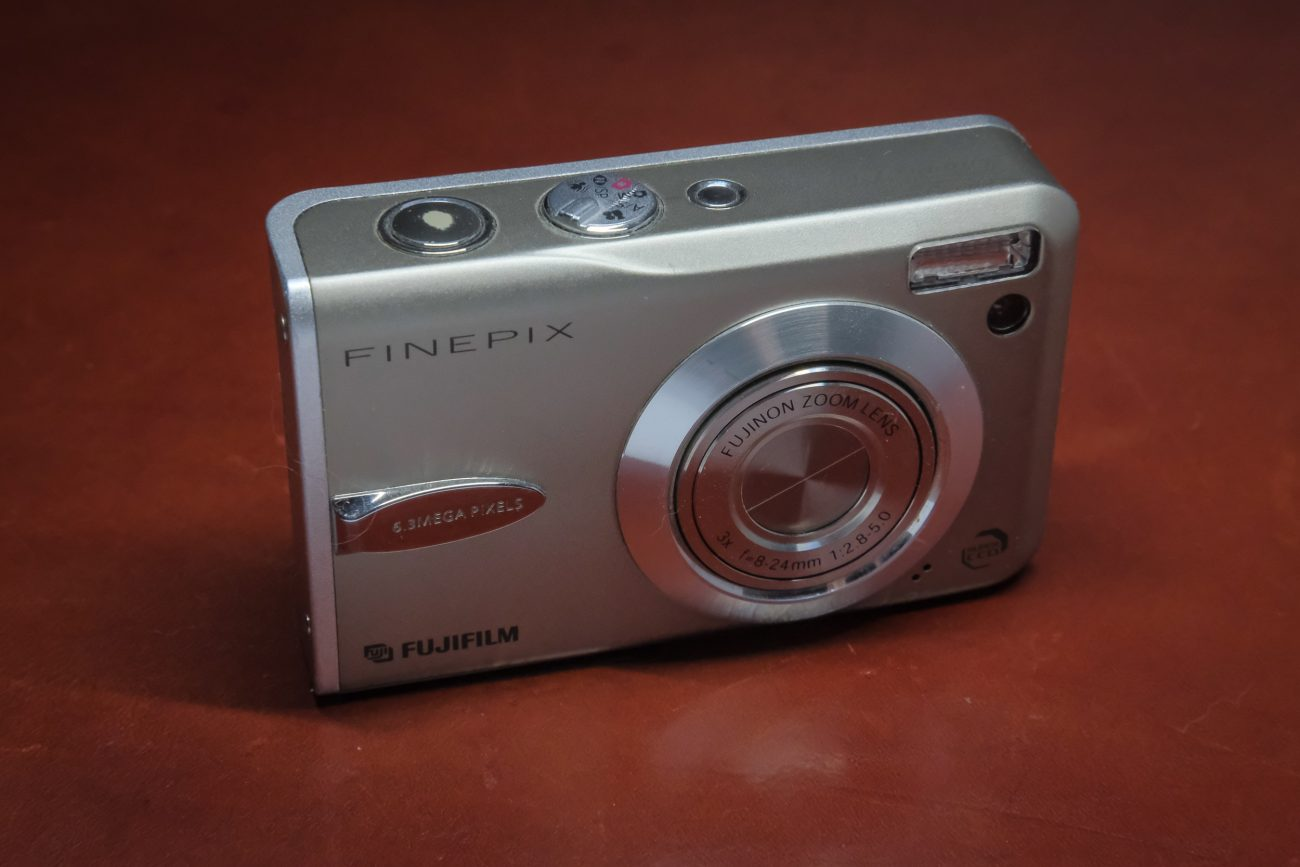 Photograph of a Fujifilm Finepix F30 digital camera with the lens retracted (off).