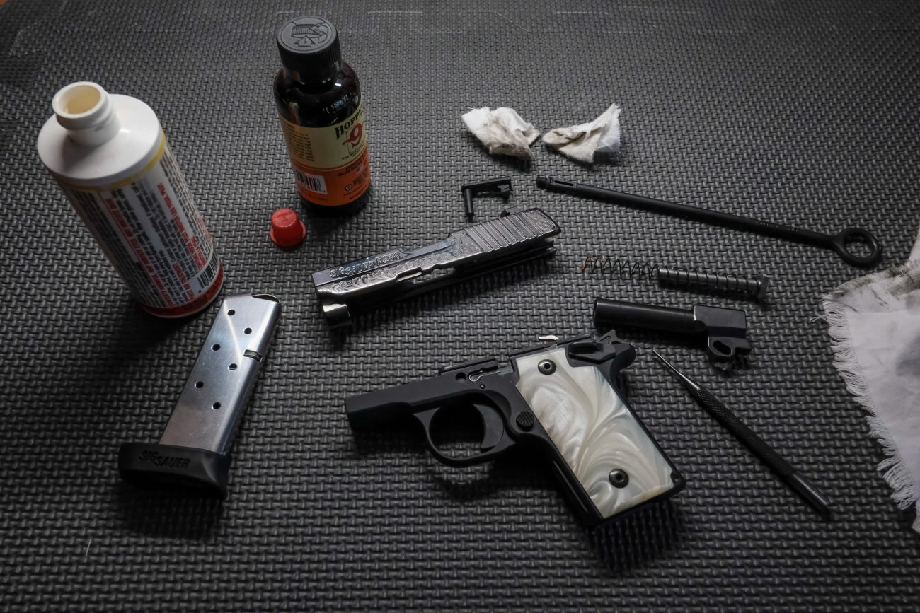 Photograph of a disassembled Sig Sauer P238 handgun.