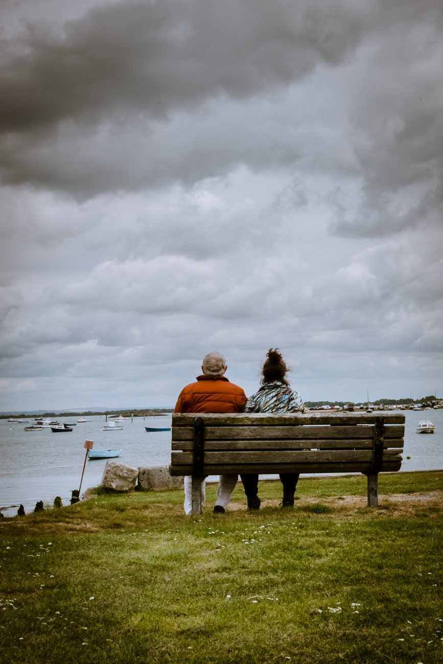 Photograph of Gary Allman and Ginger Allman sitting on a bench at Milton Locks, Langstone Harbour