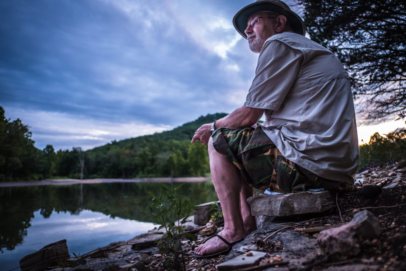 Color photograph of Gary Allman enjoying the Sunset at Table Rock Missouri (Piney Creek Wilderness).