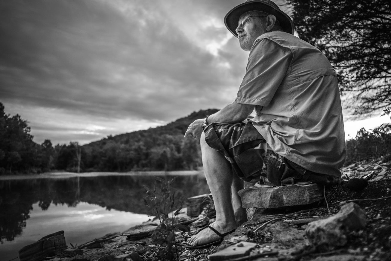 Black and white picture of Gary Allman enjoying the sunset at Piney Creek Wilderness, Missouri.