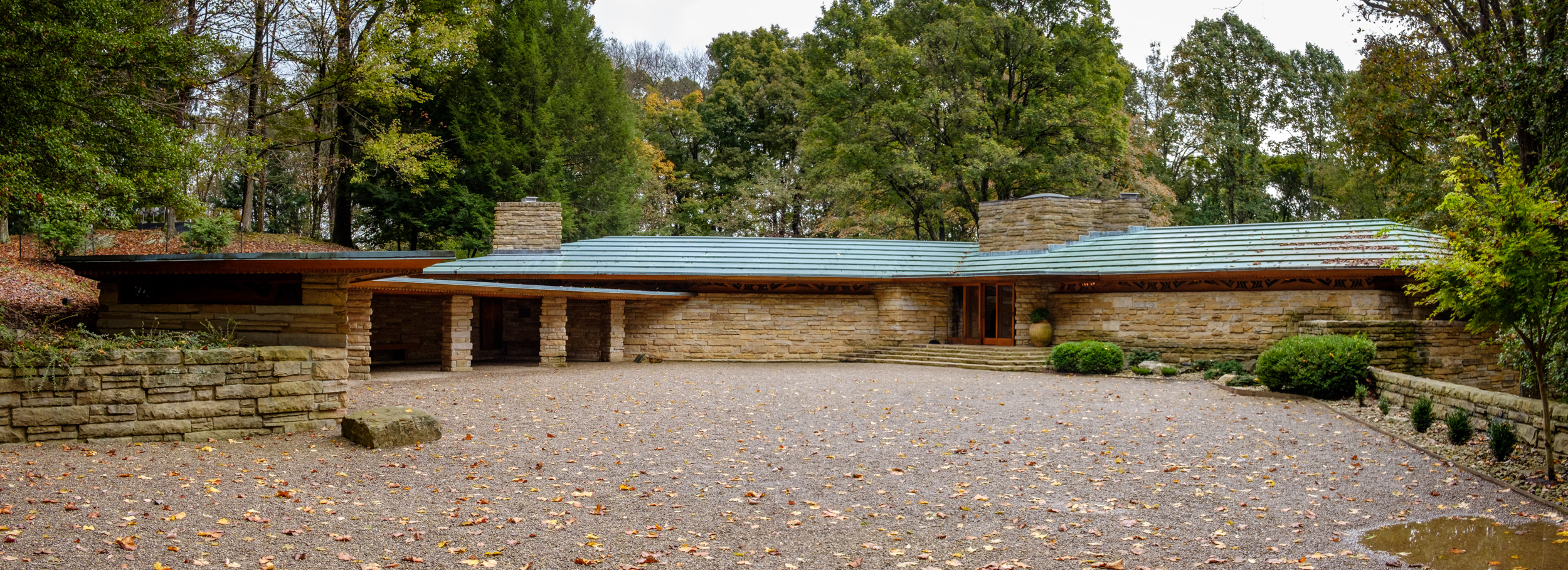Color photograph of Kentuck Knob, aka Hagan House, showing the drive, main entrance, and car port. Architect - Frank Lloyd Wright.