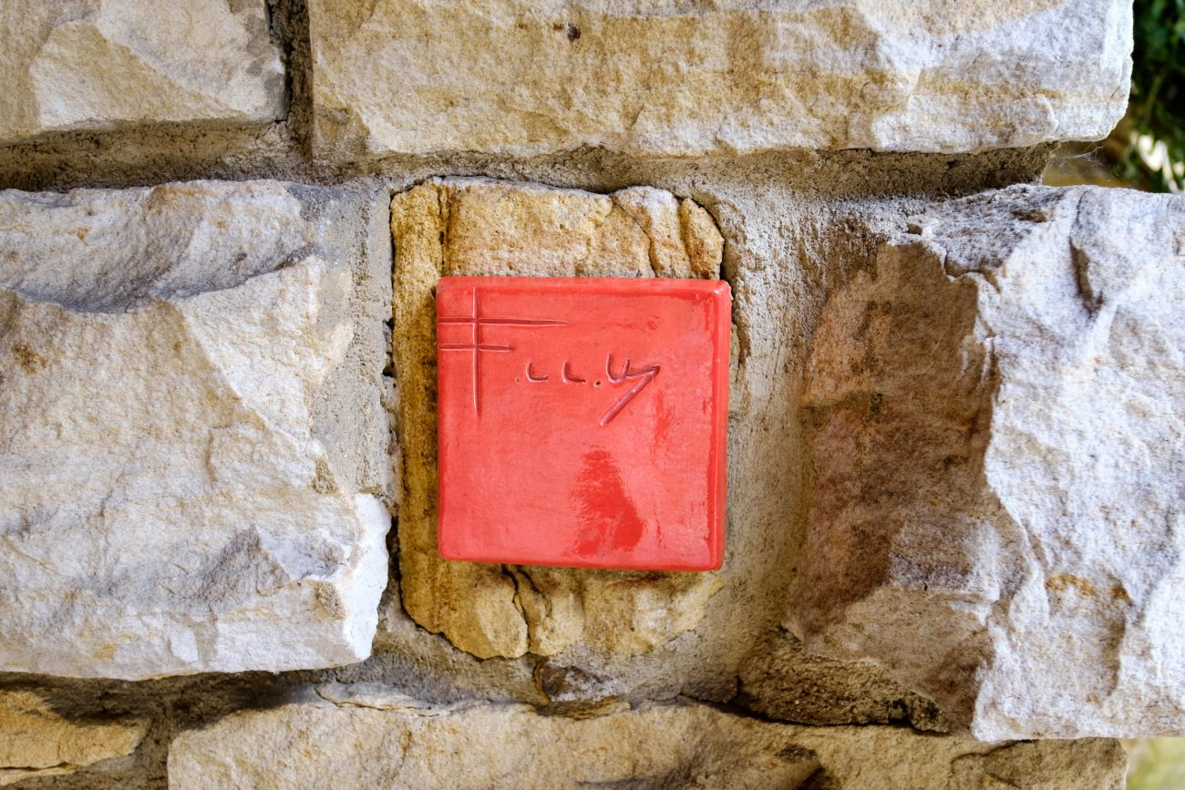 Color photograph of a Frank Lloyd Wright initial tile. Kentuck Knob.