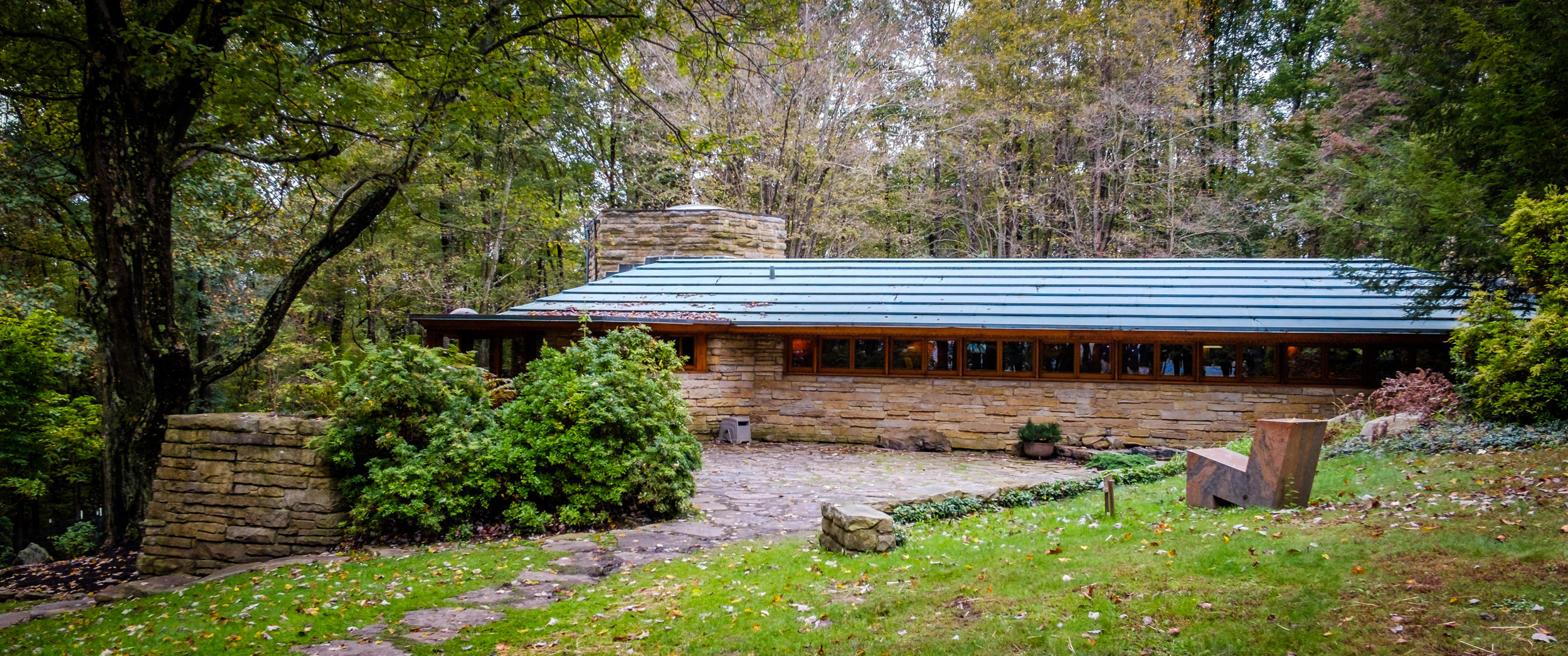 Color photograph of Kentuck Knob, aka Hagan House, showing the bedroom wing from the garden. Architect - Frank Lloyd Wright.
