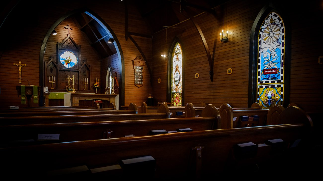 A picture showing the empty interior of Trinity Episcopal Church, Lebanon, Missouri, ready for a service on a Sunday.