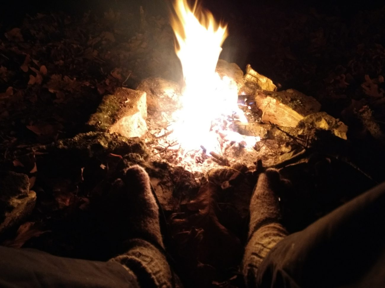 Warming my feet by the campfire.