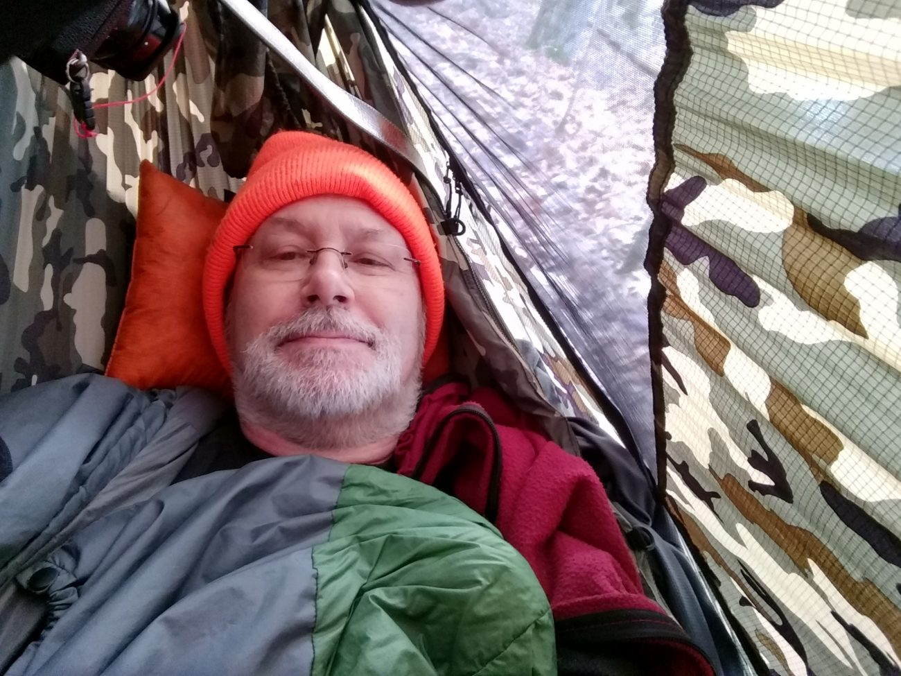 Gary Allman in a Dutchware Gear Chameleon Hammock with winter cover.