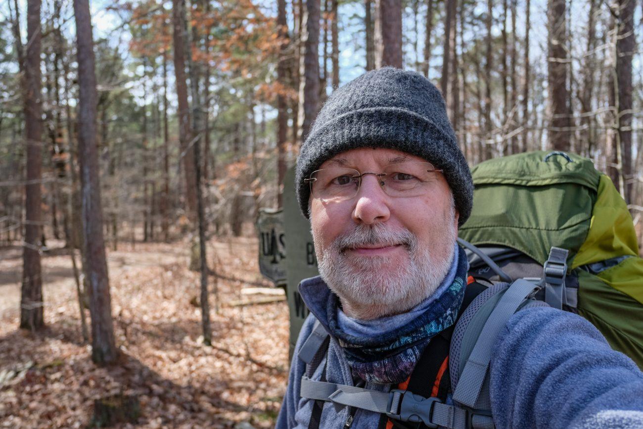Gary Allman wearing a hat at the Devil's Backbone Wilderness, Collins Ridge Trailhead in Missouri.