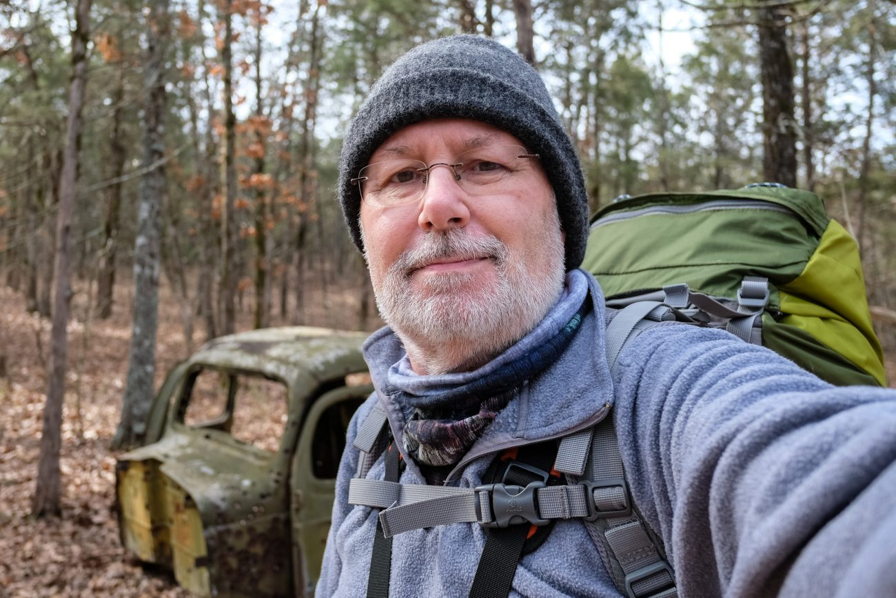 Gary Allman with the abandoned truck cab on the Pees Hollow Trail at Hercules Glades Wilderness. February 2019.