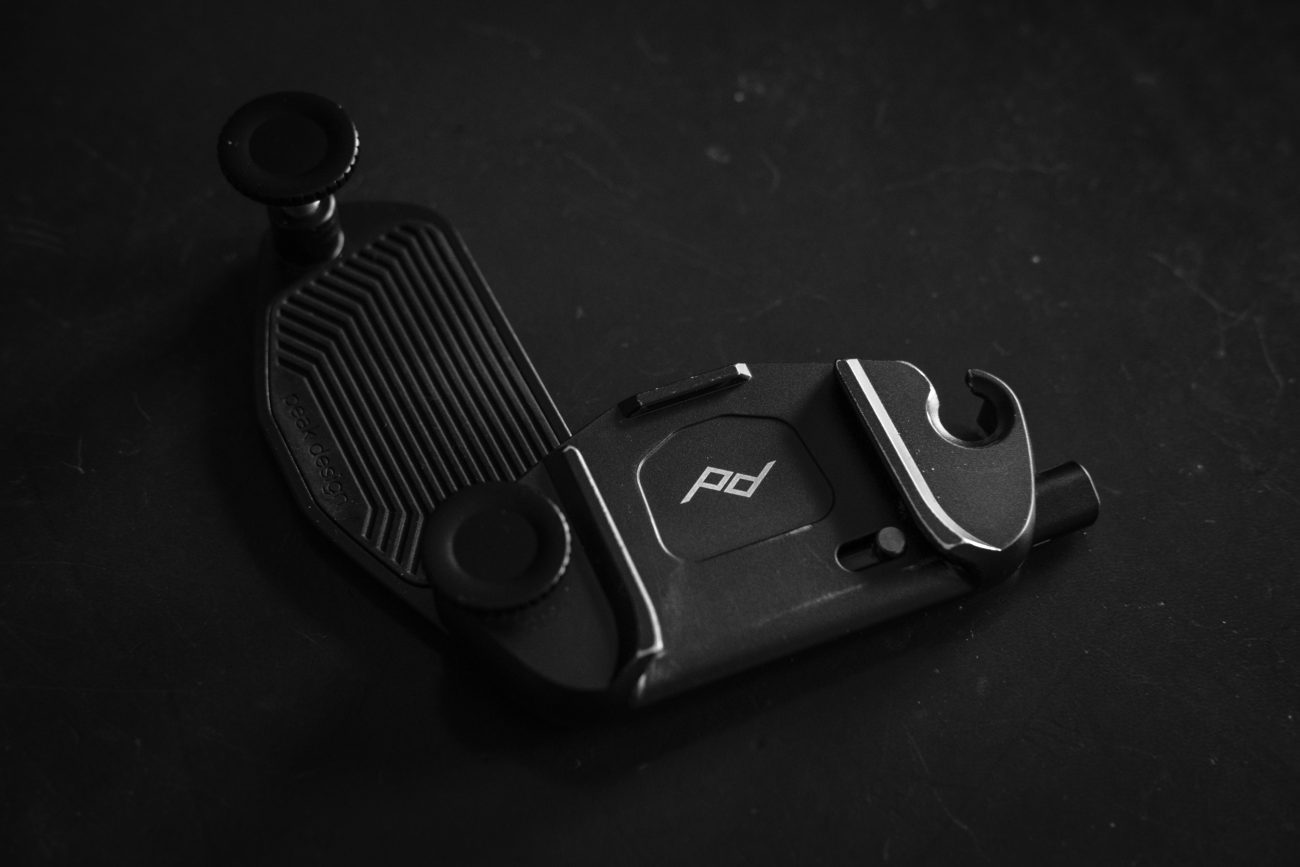 Black and white image of a Peak Design Capture Pro V3 Camera clip.